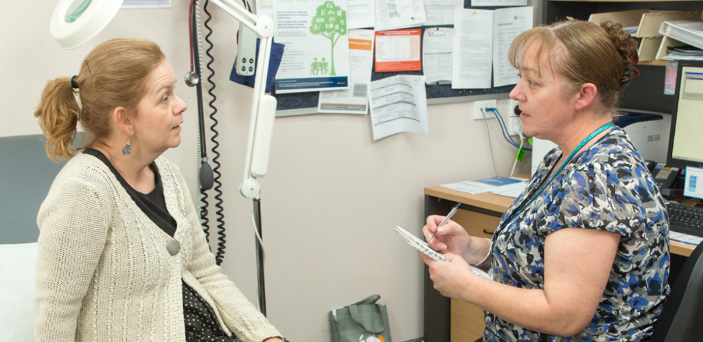 Practice nurse Kylie McLaughlin talking with a patient about the social prescribing program.