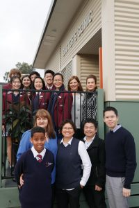 Students and teachers from Braybrook College standing with local GPs.