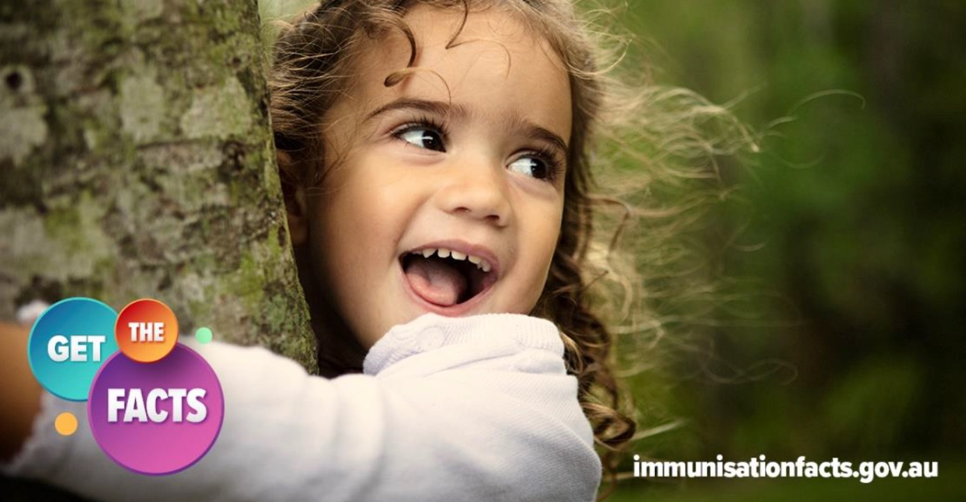 Young girl hugging a tree with 'Get the facts on immunisation' logo visible in the foreground.
