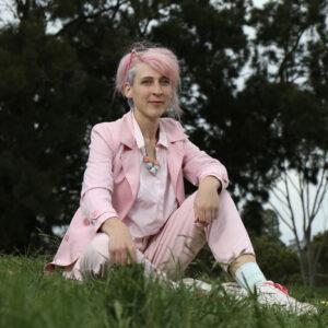Daisy Dinnage from Mind Australia sitting on grass.