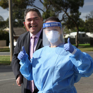 Paul Kochskamper, Practice Manager, pictured with a nurse wearing personal protective equipment at Darley Medical Centre.