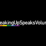 "White text on black background with rainbow motif that reads ""#SpeakingUpSpeaksVolumes"""
