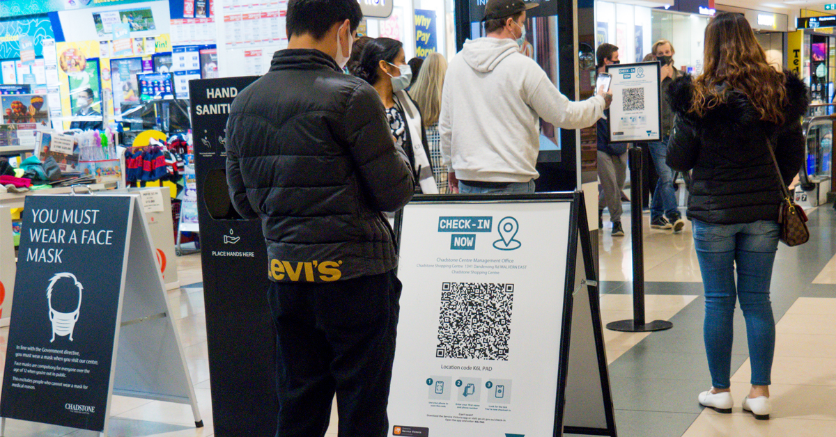 People checking in with QR codes in Victoria.